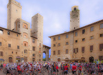 D3X 63 PI. Bicycle racing teams forming up in the main square of San Gimignano. Tuscany, Italy, Europe