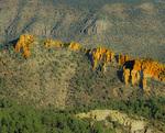 MF 498 PI.  The first shaft of sunlight illuminates a broken ridge in the Mogollon Mountains.  Gila Wilderness, NM