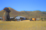 SF 2162 PI.  A decaying wigwam burner flanks a shuttered sawmill.  Chama, NM