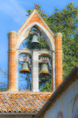 D3X 217 PI.  An unusual array of church bells atop an impoverished country church.  Tuscany, Italy.