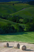 D3X 223.  Baled hay atop a plateau amidst rolling hills in a rural farming belt of Tuscany, Italy.