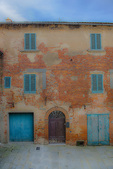D800e 265.  The fading face of an apartment building in the rural hamlet of Valiano. Tuscany, Italy.