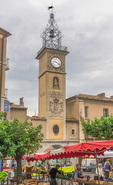 D810 46.  The Saturday produce market beneath the village clock tower of Sisteron.  Provence, France
