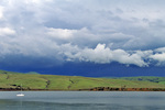 SF 40.  A receding storm system passes over a sail boat in Tomales Bay, CA