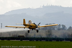 An Ayers Turbo Thrush spraying a field.