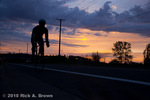 Cyclist riding at sunset MR