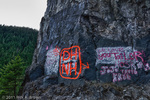 Graffiti on a roadside rock, digital composite, HDR