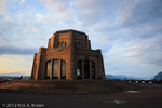 Vista House at sunset. People have gathered to watch the sunset and make photos