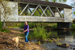 A man walks his dog near Larwood Bridge.