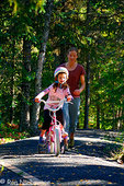 Family biking at Trail Lake Campground, Kenai Peninsula, Chugach National Forest, Alaska. (MR)