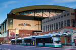 The METRO Rail train in front of the Chase Field baseball stadium, downtown Phoenix, Arizona.