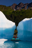 Kayaking in Bear Lagoon, Kenai Fjords National Park, near Seward, Alaska. (model released)