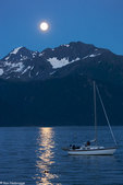 Full moon reflects on Resurrection Bay, Seward, Alaska.
