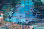 The pool of The Cosmopolitan Hotel and Casino reflect in a nearby building in City Center, Las Vegas, Nevada.