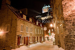 Winter's night view of the landmark Chateau Frontenac in Upper Town above the festively decorated Rue du Cul-de Sac in Lower Town in the Historic District of Old Quebec (Vieux-Quebec) - a UNESCO World Heritage Site, Quebec, Quebec. 