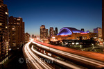 Looking out at night over the Gardiner Expressway at the Rogers Centre (formerly called the Skydome) lit up with purple lights in downtown Toronto, Ontario