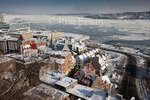 View from above of the Old Port of Quebec and the partially frozen St. Lawrence River in the old City of Quebec, Quebec