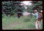 Using pepper spray to deter aggressive black bear.