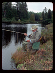 John Voelker (Robert Traver) lands a Brook Trout he caught on a fly.