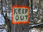 Keep Out Sign Painted on Tree of Private Property.
