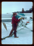 Pilot Don Glaser warms airplane engine at Windigo prior to flight to monitor wolves during winter at Isle Royale National Park.