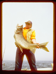 Dave Raikko with a 25 pound Lake Trout he caught from Lake Superior.