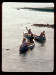 Family of canoeists in Minnesota's Boundary Waters Canoe Area.