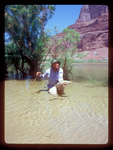 Fisherman displays a rainbow trout caught from the Colorado River in the Grand Canyon.