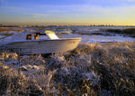 Stranded Wooden Boat In Ice Storm