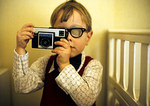 Young Photographer With Instamatic