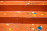 Orange painted wet stoop after November rains