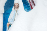 A Madonna religious statue after blizzard