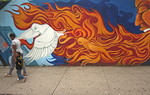 Street mural with fire, dove and pedestrians