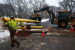 Workers laying outdoor pipes
