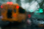 Schoolbus and traffic in July downpour