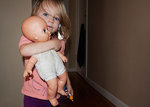 Toddler and doll with blue eyes