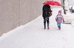 Winter walk with red umbrella