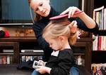 mom brushing daughter's hair