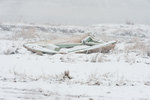 Abandoned boat in snowstorm