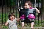 Baby sister on the swings