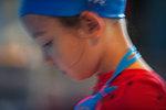 Girl with blue swim cap