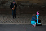 Child and street musician in Central Park New York City