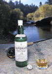 single malt scotch streamside with flyrod/reel