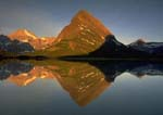 GRINNELL POINT AND MOUNT GOULD, Sunrise Reflection in Swiftcurrent Lake.